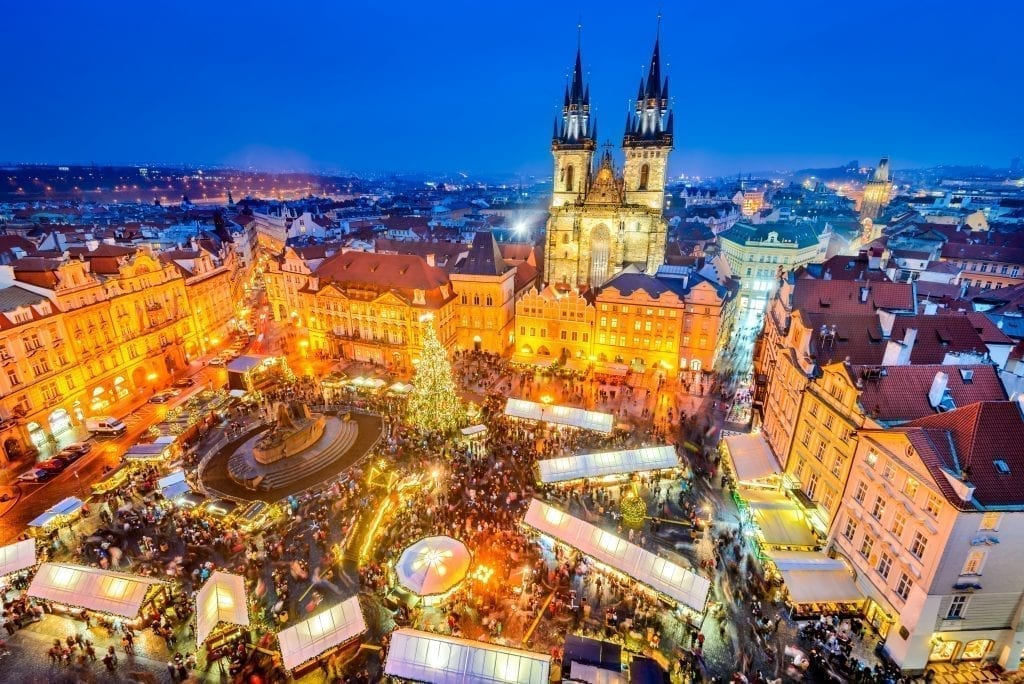 Prage Christmas market in its central square as seen from above during blue hour. Prague has some of the best Christmas markets in Europe