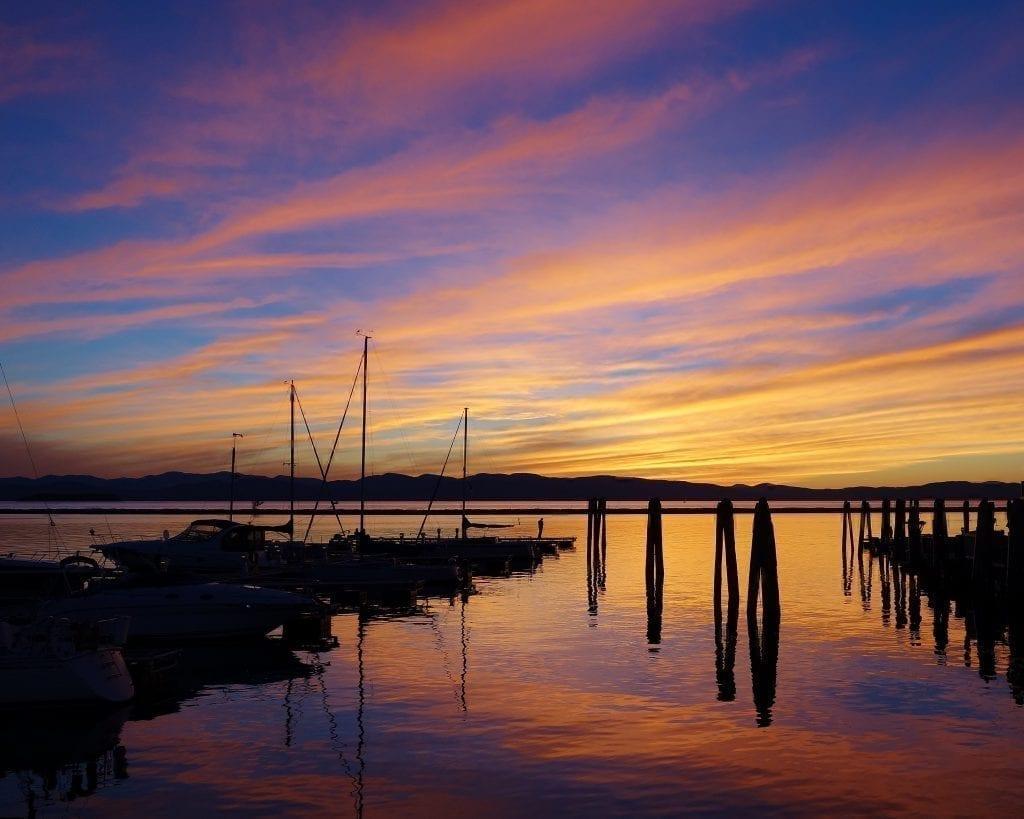 bright orange sunset over lake champlain