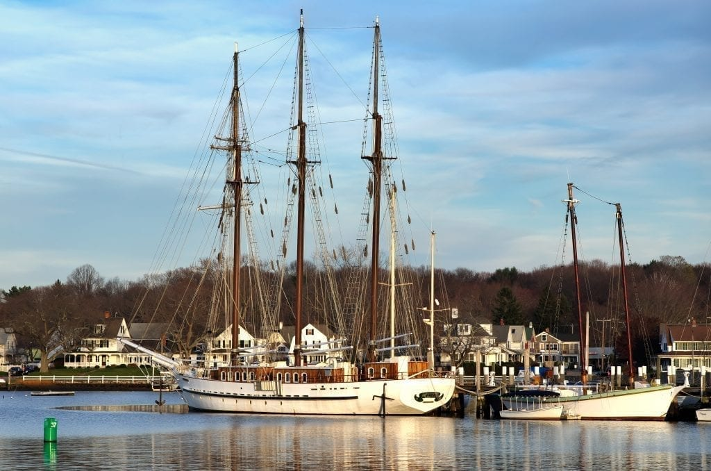 Historic tall ship in the harbor of Mystic Connecticut, one of the best weekend getaways from Boston ma