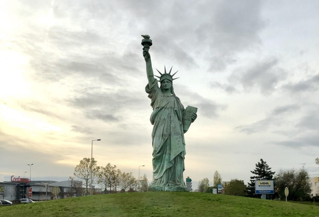 Photo of the replica of the Statue of Liberty in Colmar France on a cloudy day near sunset