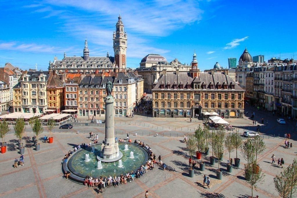 vieux lille as seen from above with a fountain in the foreground