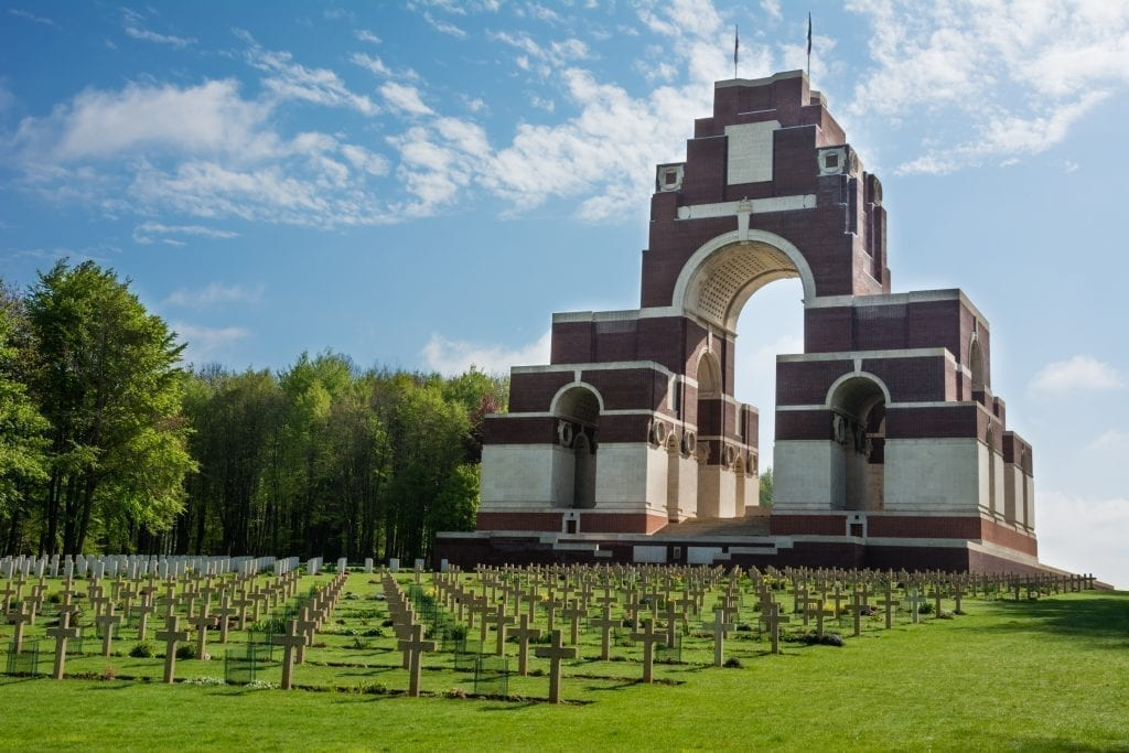 WWI Battlefield memorial with a large structure in the background and crosses in the foreground