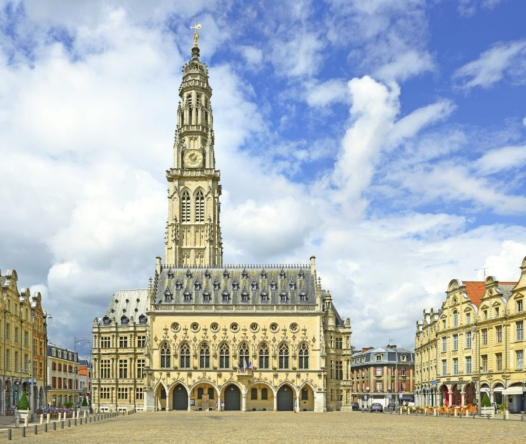 Arras France town hall as seen across an empty square. Arras is one of the best day tours from Paris France