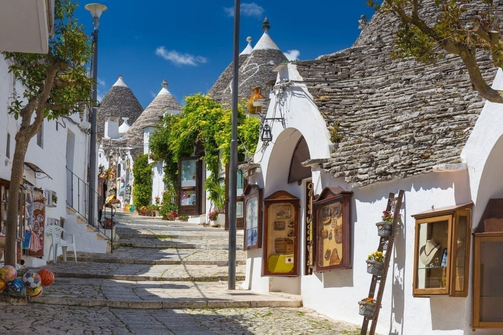 Small street in Alberobello Italy lined with trulli, one of the best travel destinations in Italy