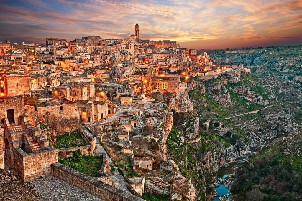 View of Matera at sunset from outside the city, one of the best Italy travel destinations