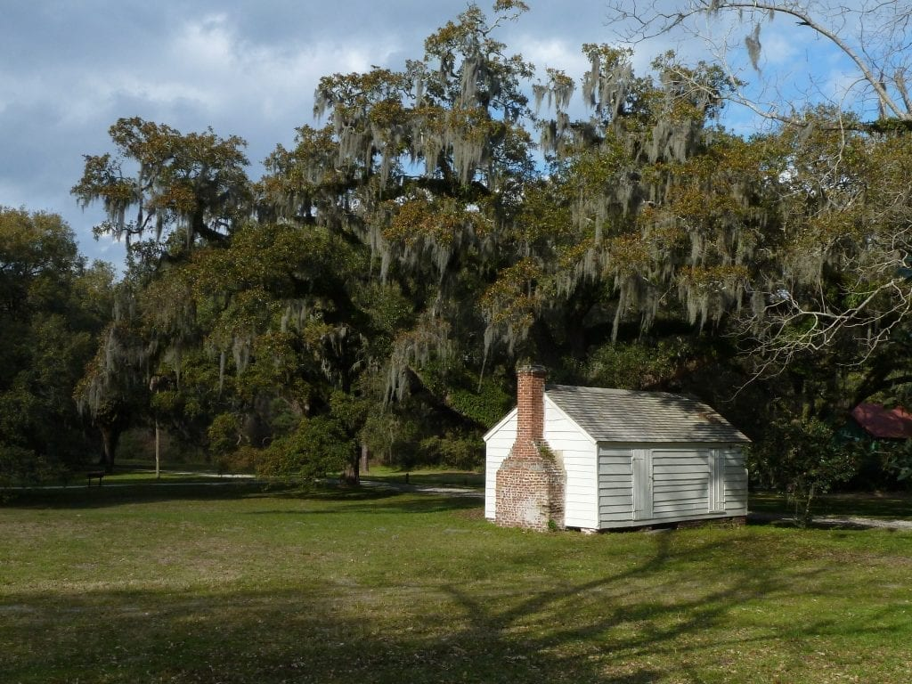 Small white cabin that enslaved people lived in on Mcleod plantation near charleston sc