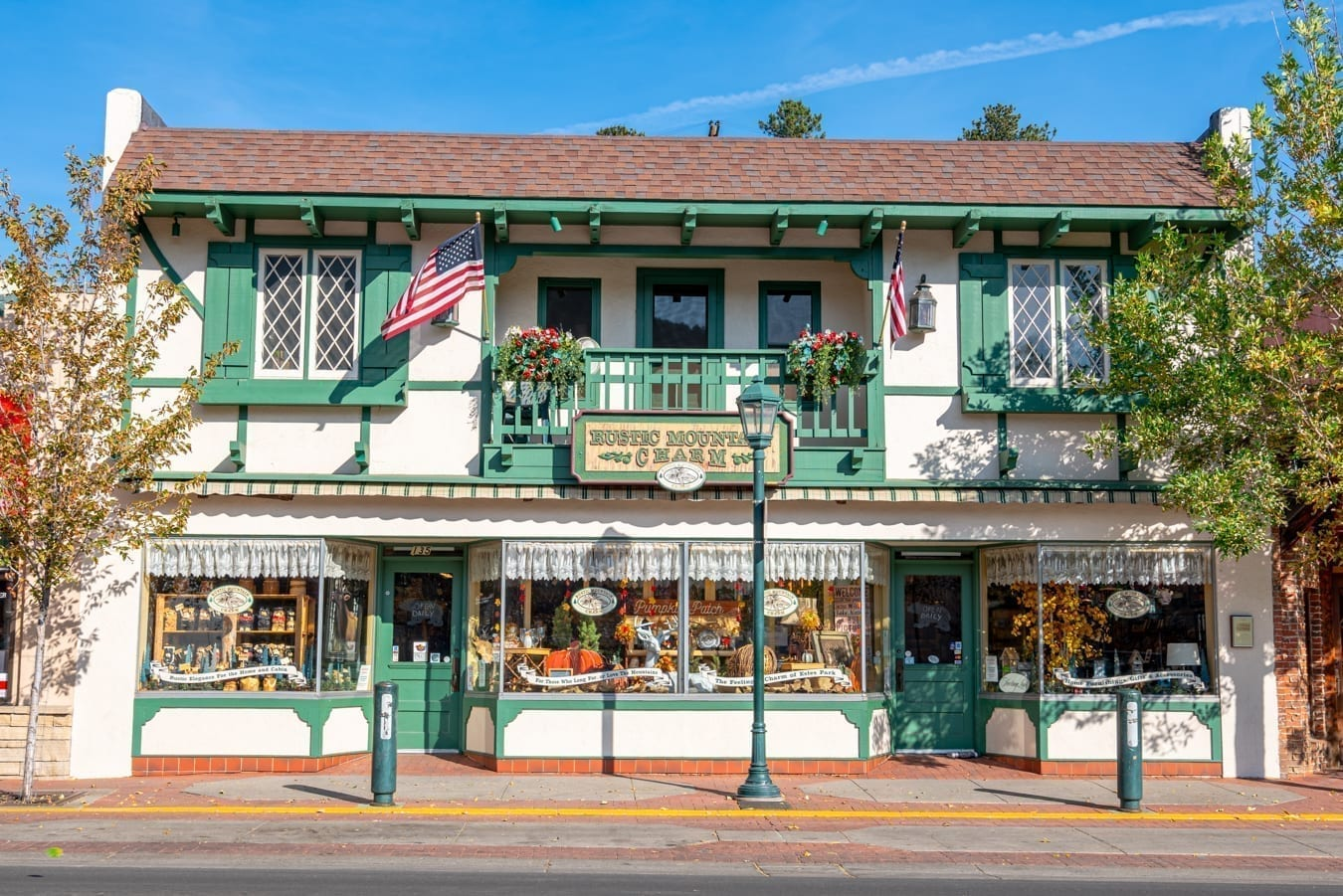 white and green shop in downtown estes park. shopping downtown is one of the best things to do in estes park colorado