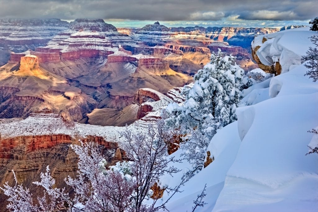 Grand Canyon in winter taken from the rim with snow in the foreground