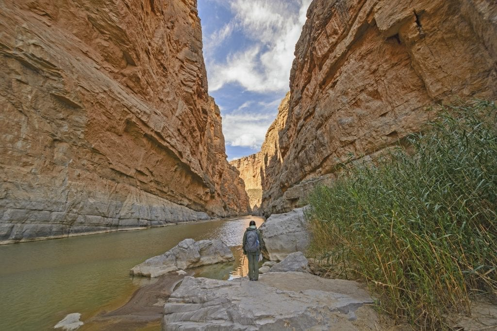 hiker standing in santa elena canyon in big bend national park texas, one of the coolest usa national parks to visit winter