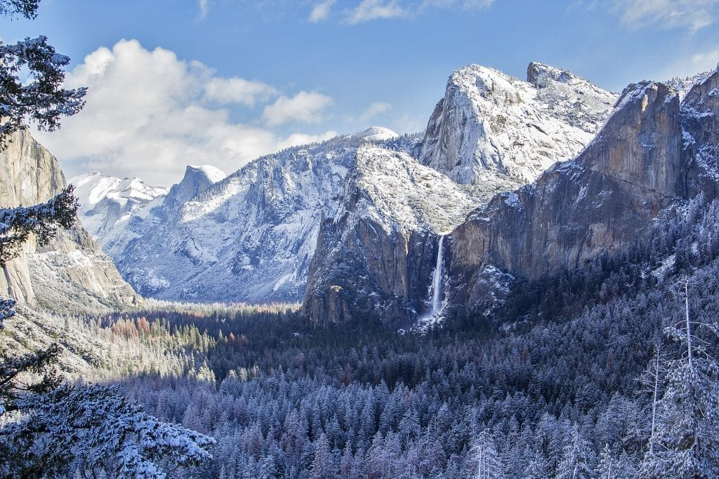 view of half dome and yosemite falls in winter from across the valley