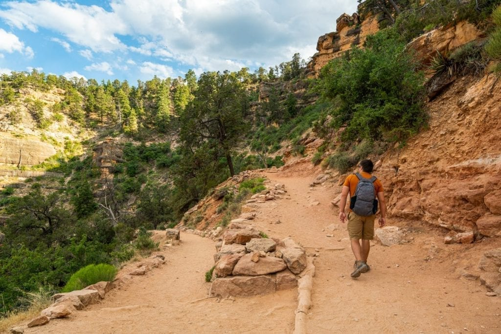 jeremy storm hiking grand canyon south rim bright angel trail, relatively flat portion with greenery