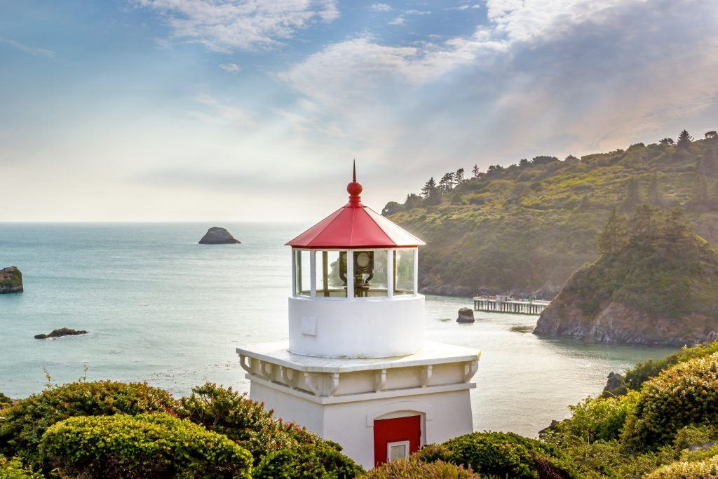 white and red lighthouse in trinidad california, one of the prettiest small towns in america