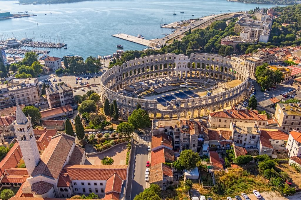 pula croatia as seen from above via a drone with amphitheater in the center. pula is one of the best places to visit in croatia