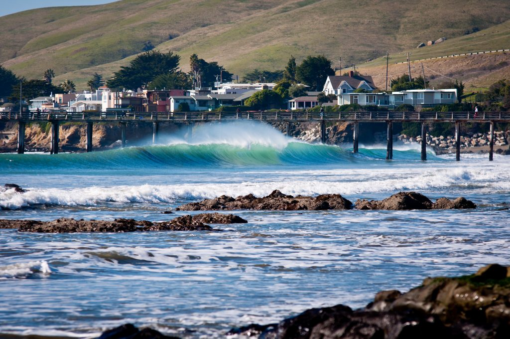 cayucos california as seen from across the water, one of the best small towns in usa