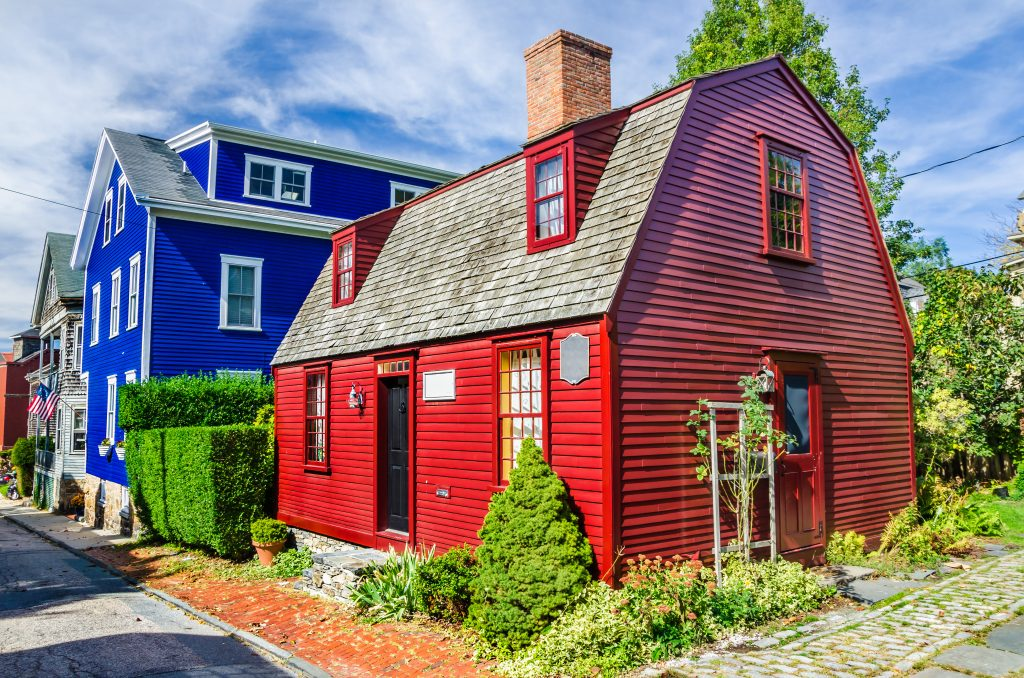 bright red and blue buildings in newport, one of the most beautiful small american towns