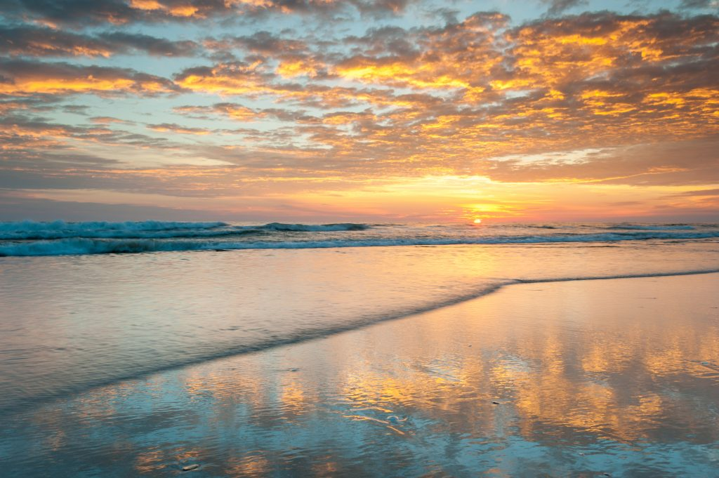 sunrise over outer banks beach. hatteras is one of the most beautiful small towns in america