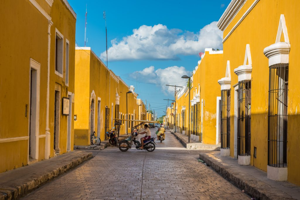 street lined with yellow buildings izamal mexico