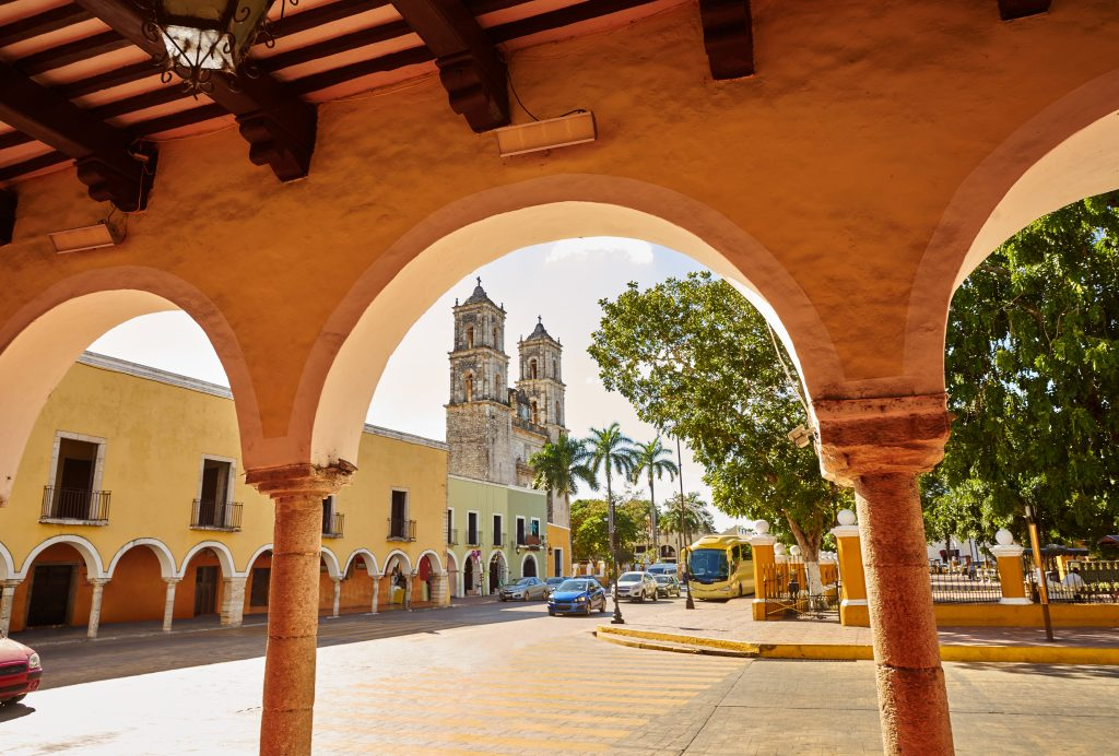 view of valladolid zocalo from under a portico. the zocalo is one of the best things to do in valladolid mexico