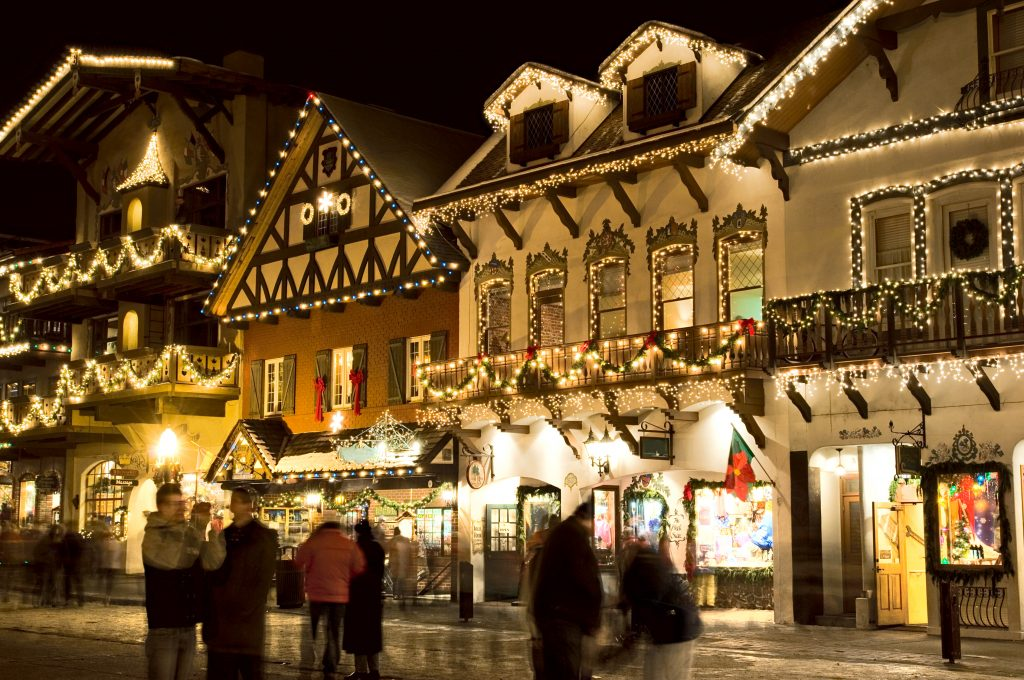leavenworth washington at night during the christmas season with lights on all buildings, one of the most beautiful usa small towns