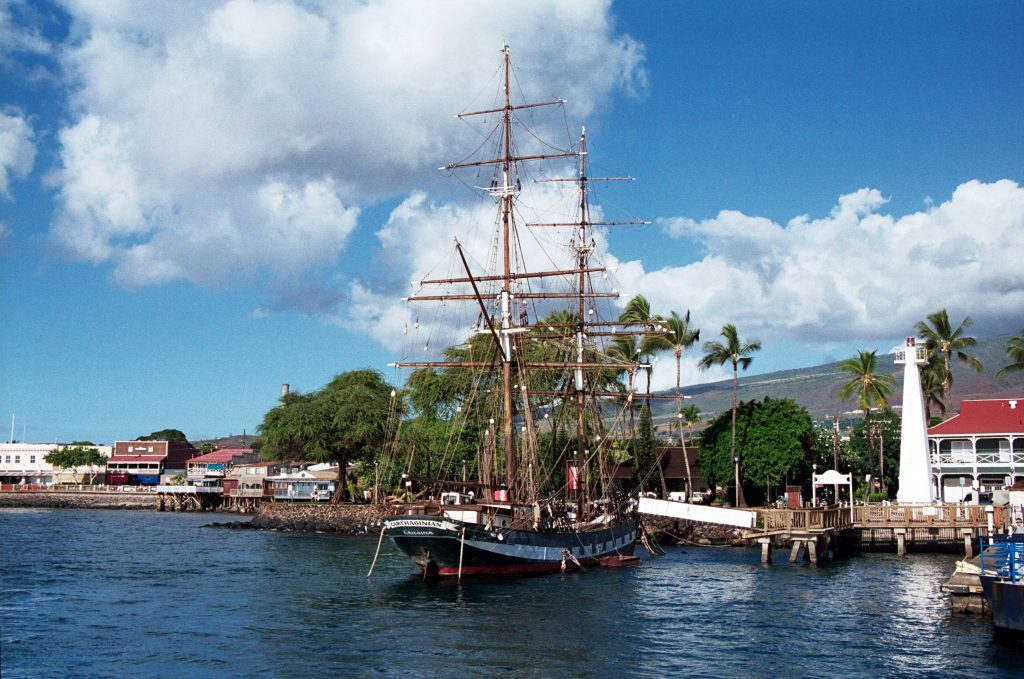 lahaina maui harbor with a tall ship in it, one of the best small us towns