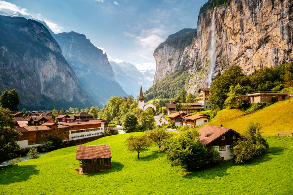 village of lauterbrannen switzerland with waterfall visible on the right