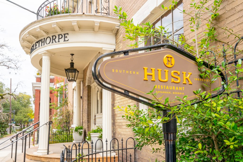 exterior of husk showing its sign, one of the best restaurants in savannah ga