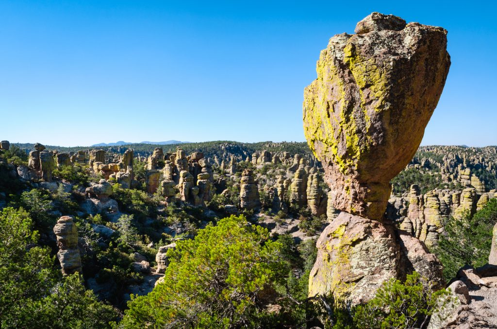 view of Chiricahua National Monument with a large, balancing boulder in the foreground.