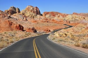 winding road through a rocky landscape on a usa southwest road trip itinerary