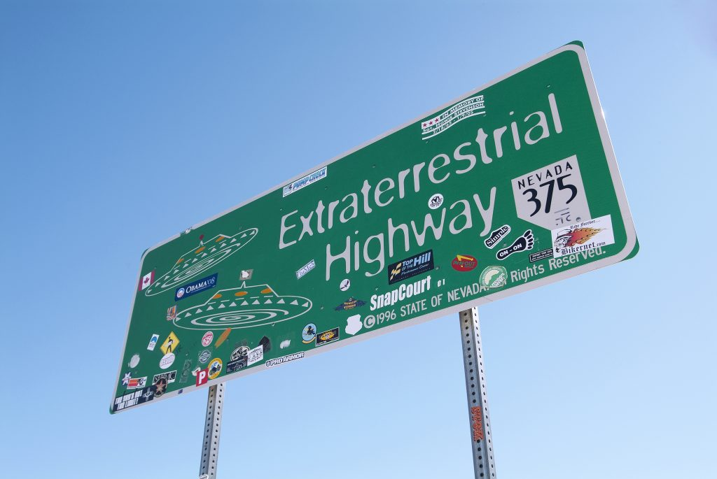 """photo of a green sign in nevada reading """"extraterrestrial highway"""", as seen during one of the best southwest road trip itinerary ideas"""