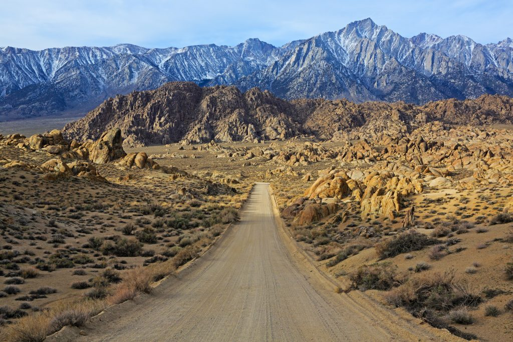 dirt road in alabama hills of california, as seen on a southwest road trip itinerary route