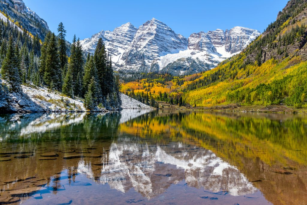 marroon bells snow covered mountains and lake in colorado
