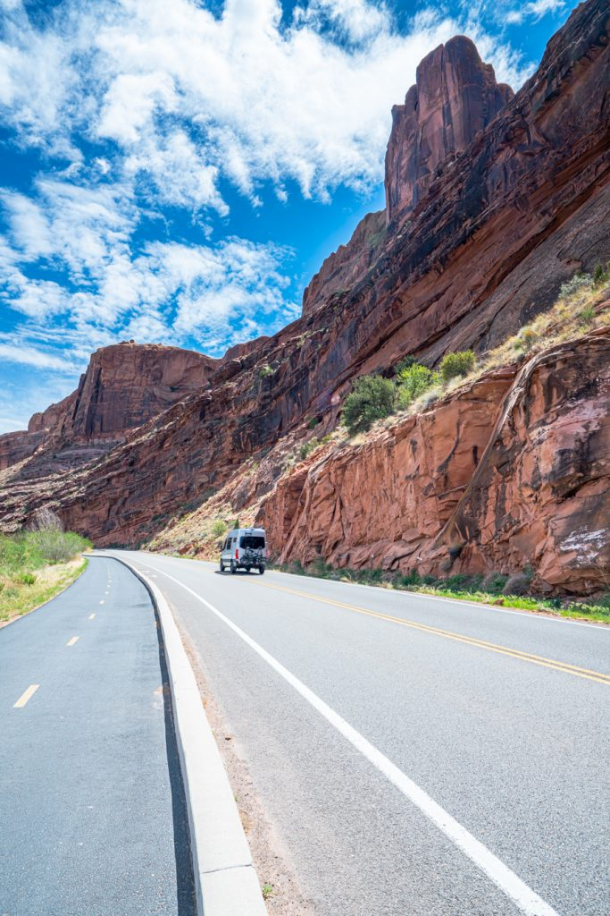 campervan driving along river road, one of the best things to do in moab utah
