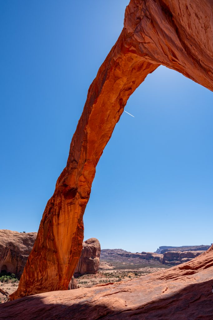 vertical photo of corona arch utah as taken from under the arch