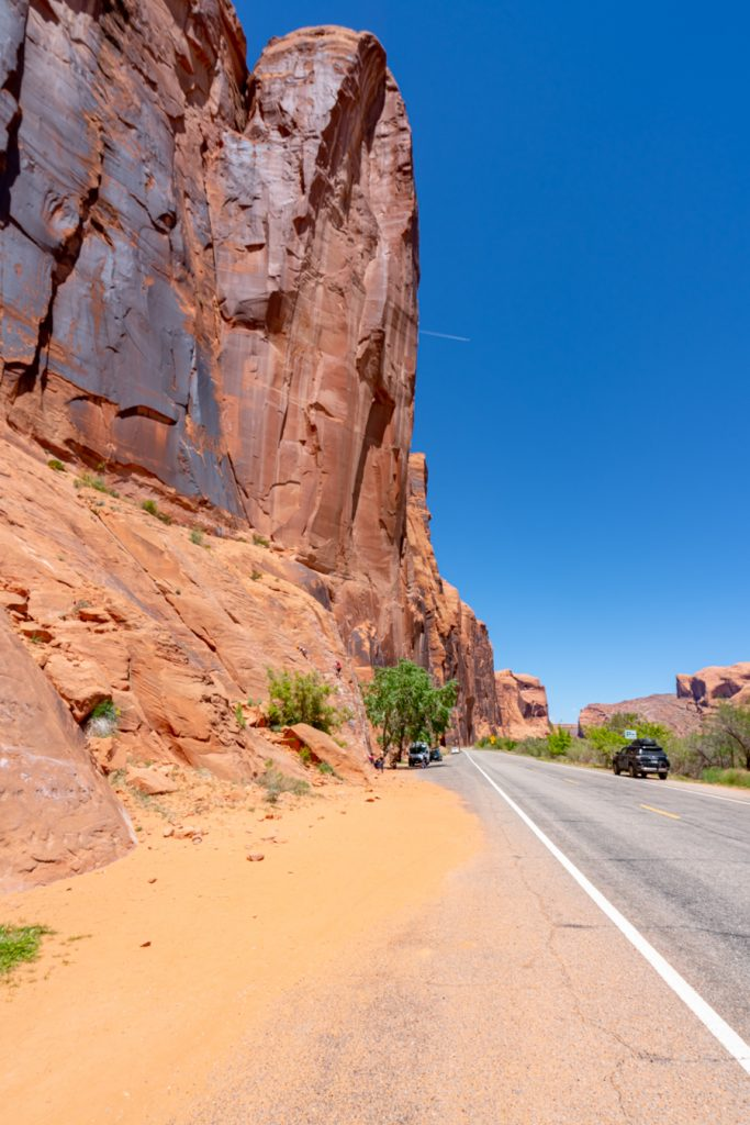 towering canyon walls along potash road, one of the best scenic drives to visit moab utah