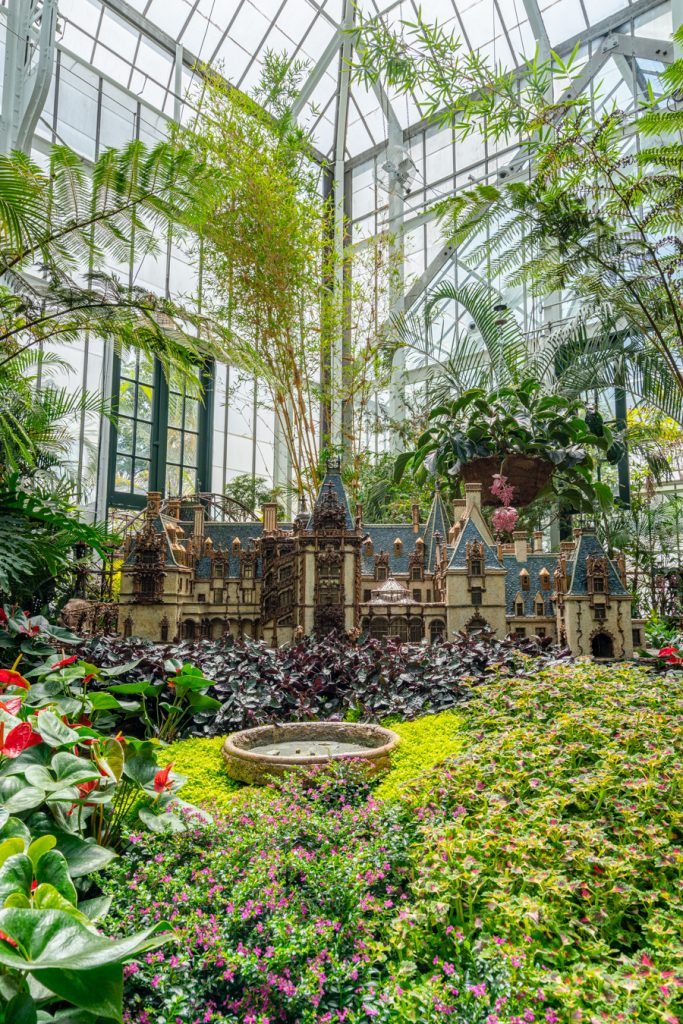 model of biltmore house inside conservatory. one of our tips for visiting biltmore is not to skip the conservatory