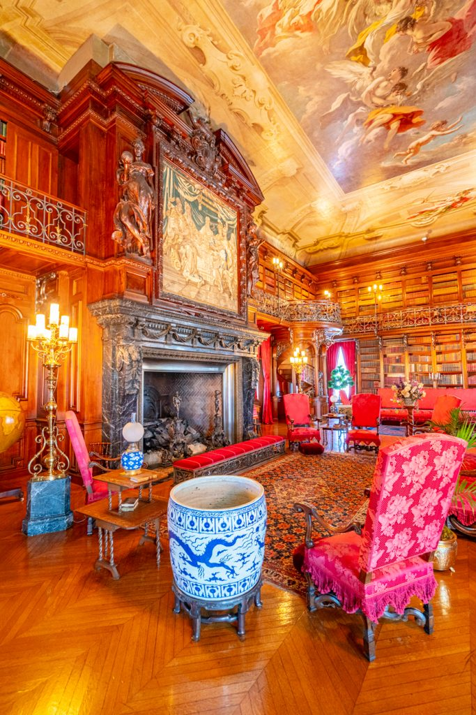 historic library with fireplace in biltmore house, one of the best places to visit at biltmore north carolina