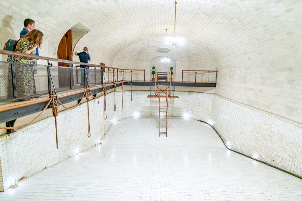 drained swimming pool inside basement biltmore house