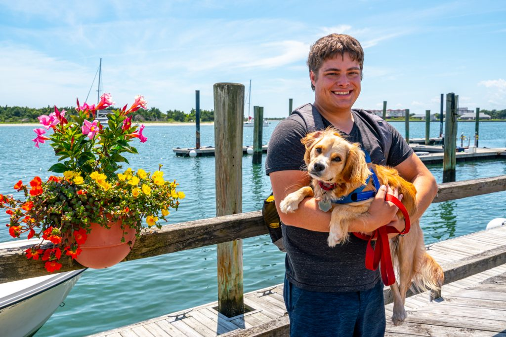 jeremy storm holding ranger storm in front of the beaufort nc waterfront