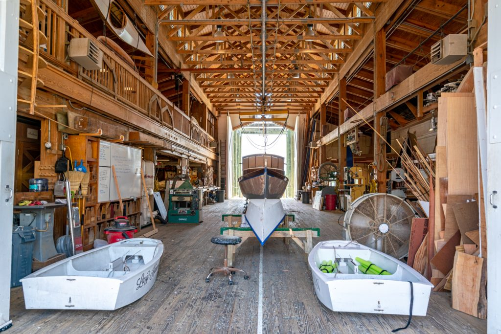 interior of the harvey w smith watercraft center with boat being built in the center, one of the top beaufort attractions