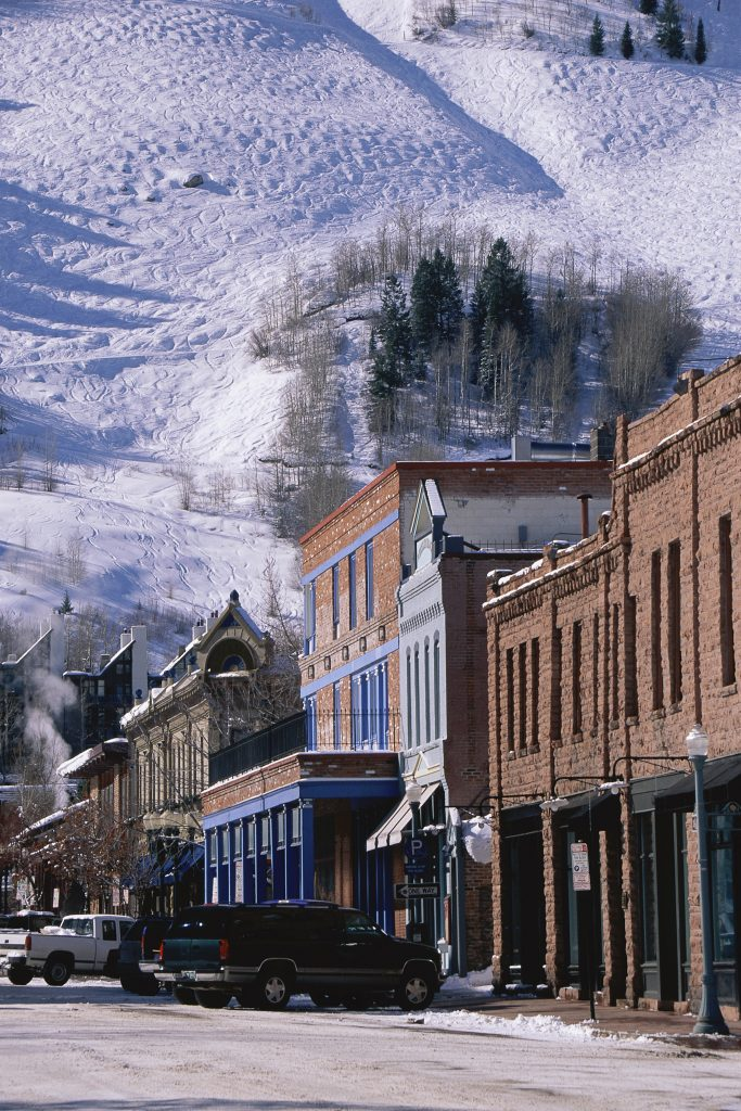 downtown aspen colorado in winter with snow in the background