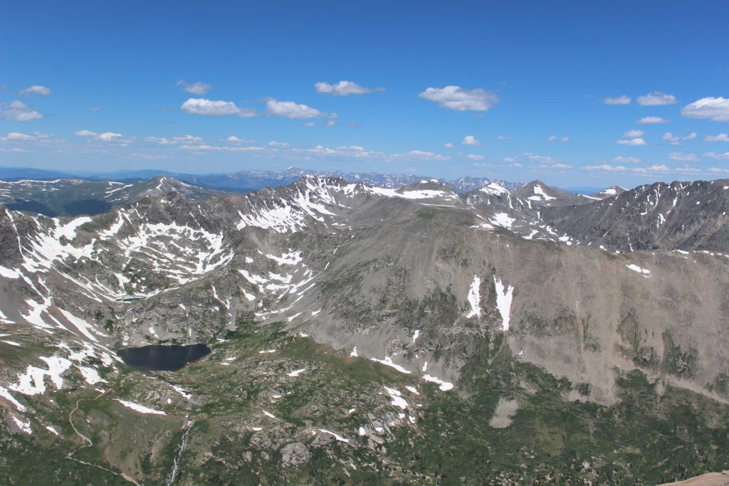 view of rocky mountains from summit of mount evans co