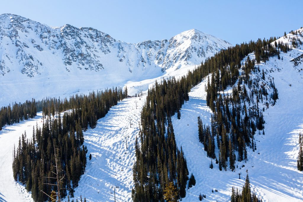 ski slopes covered in snow in vail colorado, one of the best vacation spots in colorado