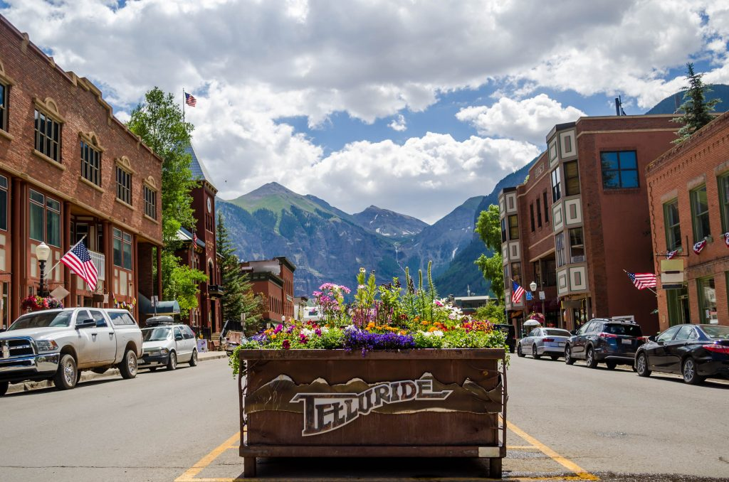 downtown telluride colorad with mountains in the background, one of the best colorado travel destinations