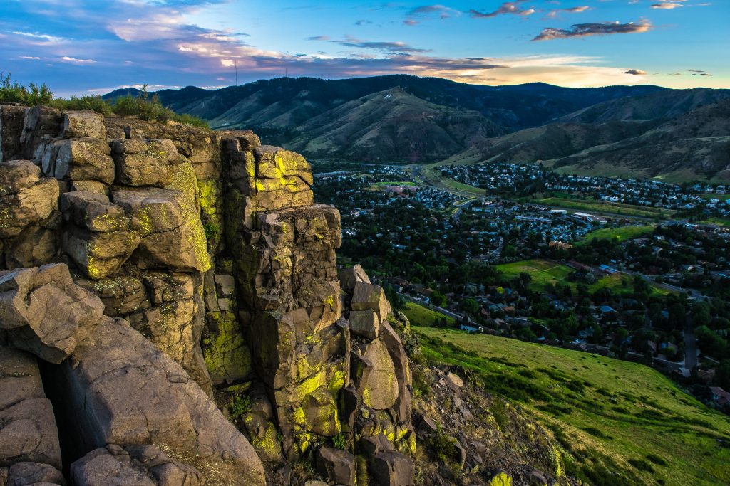 sunset over golden co as seen from a mountain ledge