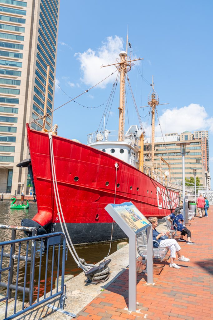 bright red historic ship in inner harbor, one of the best things to do in baltimore this weekend