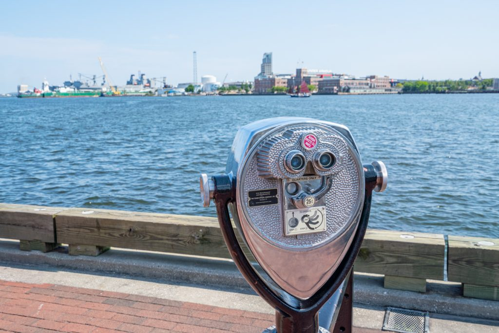 sightseeing binoculors on the edge of the water, as seen during a 3 day weekend in baltimore itinerary