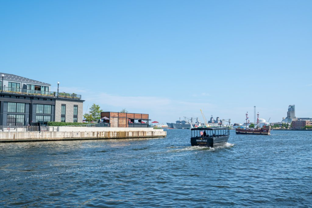 small boats heading out into the water in baltimore maryland