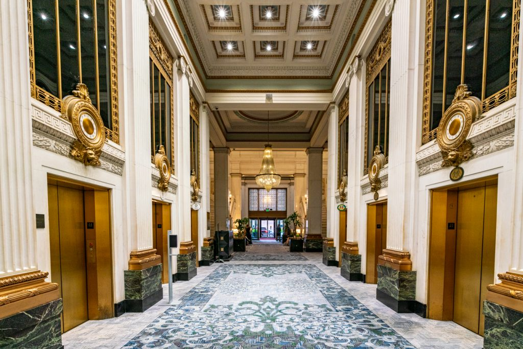 bank of gold elevators in historic kimpton monaco hotel baltimore, one of the best places to stay during a long weekend in baltimore maryland