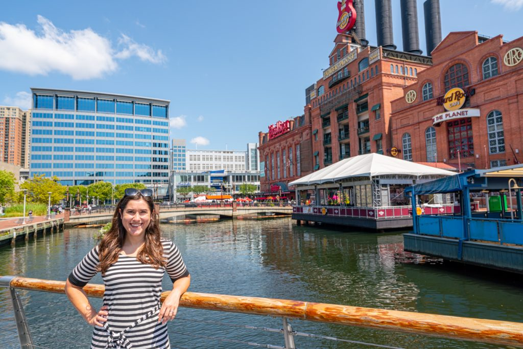 kate storm in a striped dress sightseeing in baltimore inner harbor