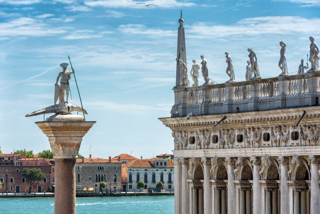 view of statue of san todaro in venice italy with lagoon in the background